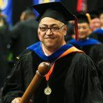 Bachri Honor Professor leading graduation procession